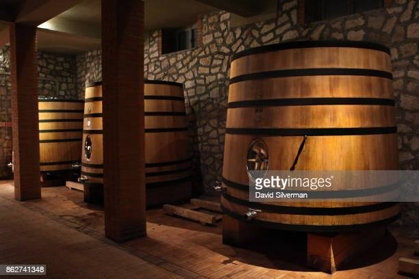 Wooden oak tanks known as foudres are used for fermenting wine at the Poliziano winery on July 23 2015 in Montepulciano Stazione Tuscany Italy...
