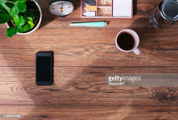 wooden office desk with smartphone and coffee mug, top view - directly above stock pictures, royalty-free photos & images