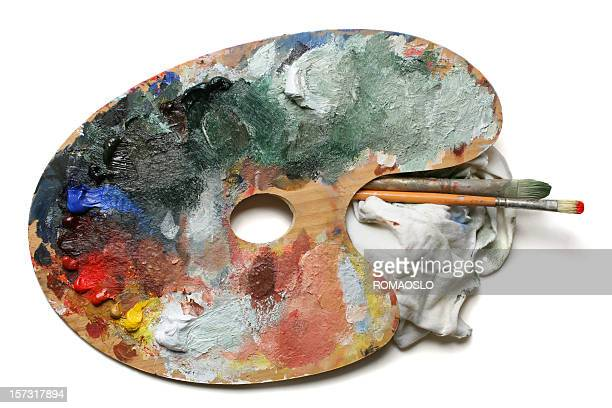 Wooden palette with oil paint on white