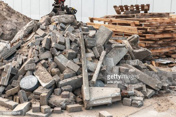 wooden pallets and concrete waste on a heap - rubble stock pictures, royalty-free photos & images