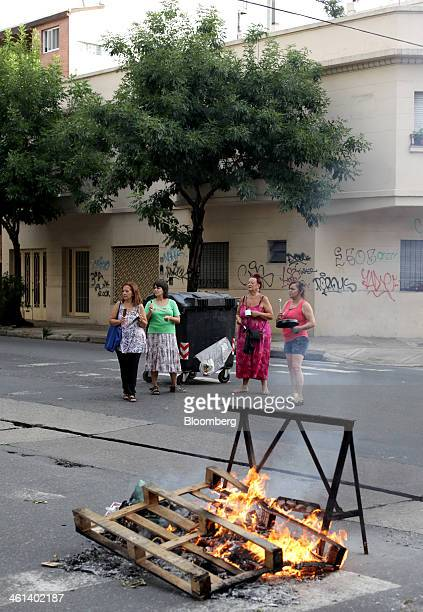 Wooden pallets are burned on a street in protest in the Villa Crespo neighborhood of Buenos Aires Argentina on Tuesday Jan 7 2014 Empresa...