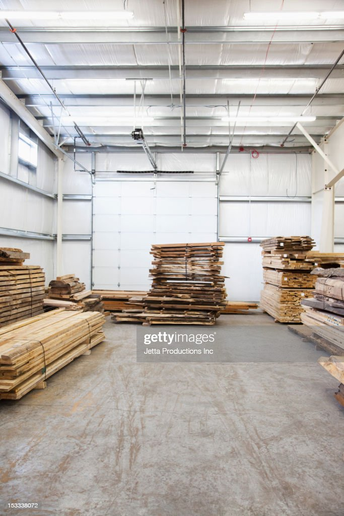 Wooden pallets in factory warehouse : Stock Photo