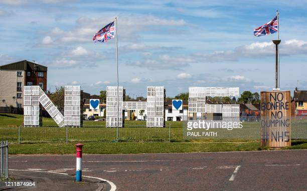 Wooden Pallets spelling out NHS, to show support and thanks for the National Health Service, are pictured in the Loyalist area of Portadown, in east...