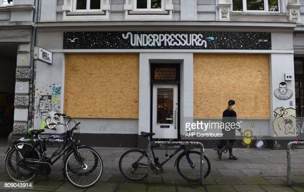 Wooden panels are nailed on windows to protect a shop against riot damages on July 5 2017 in Hamburg northern Germany where leaders of the world's...