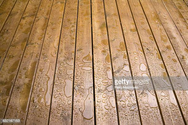 Wooden patio deck surface with water repellant stain applied