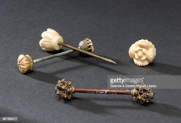 Wooden penis pin or �ampellang� in the local language with silver filigree end pieces Shown with two other penis pins all from Borneo