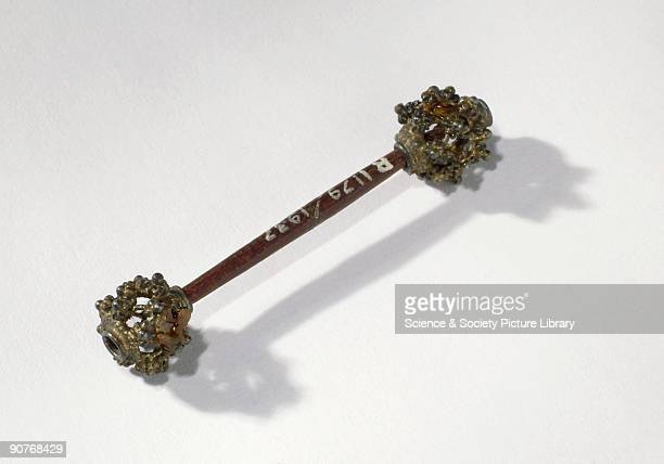 Wooden penis pin or �ampellang� in the local language with silver filigree end pieces