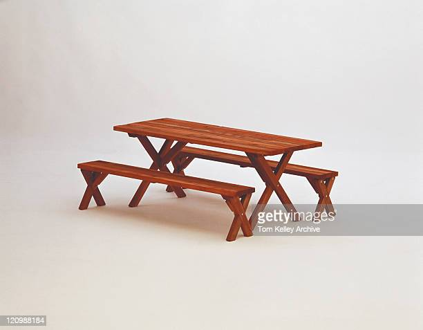 Wooden picnic table on white background