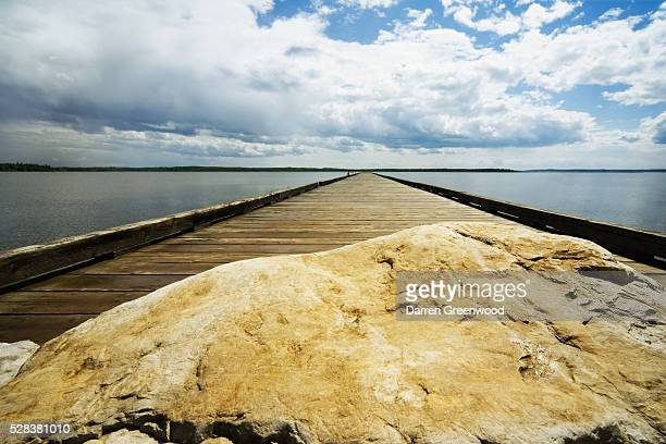 Wooden pier and rock
