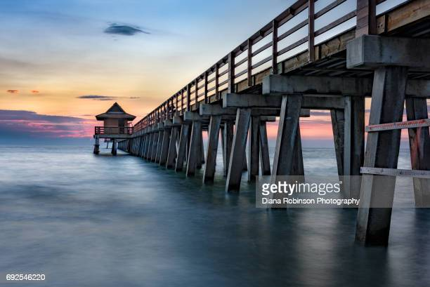 wooden pier at naples, florida - naples florida stock pictures, royalty-free photos & images