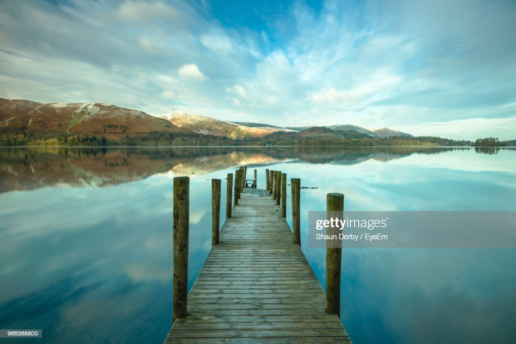Wooden Pier In Lake Against Sky : Stock Photo