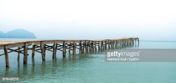 Wooden Pier In Sea Against Clear Sky