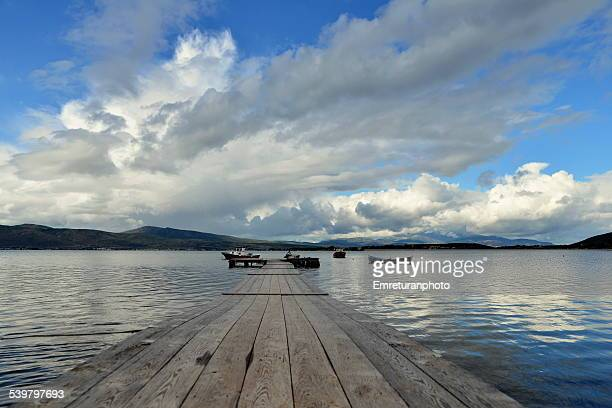 wooden pier in the bay of gullubahce - emreturanphoto stock pictures, royalty-free photos & images