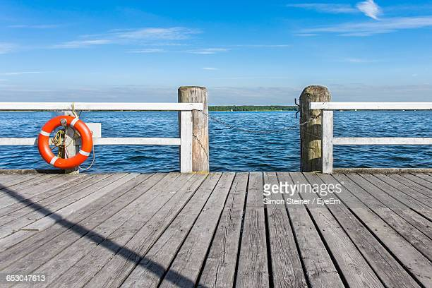 wooden pier on beach against sky - pier stock pictures, royalty-free photos & images