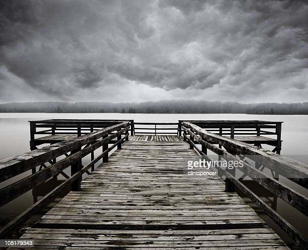 Wooden Pier on Lake During Stormy, Overcast Day