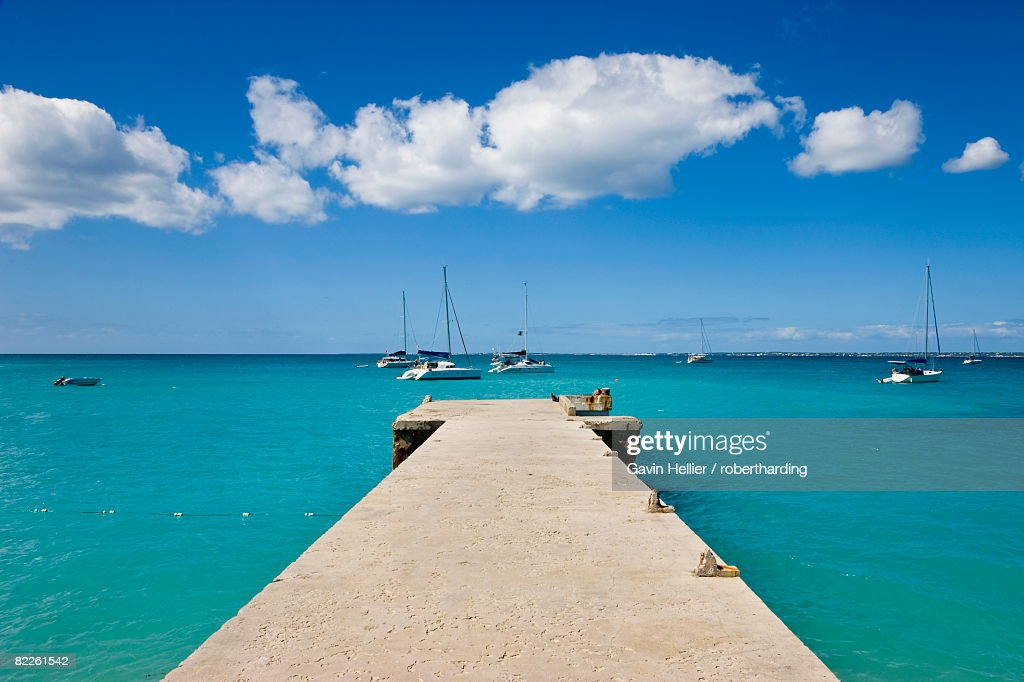 Wooden pier on the beach at Grand-Case on the French side, St. Martin, Leeward Islands, West Indies, Caribbean, Central America : Stock Photo