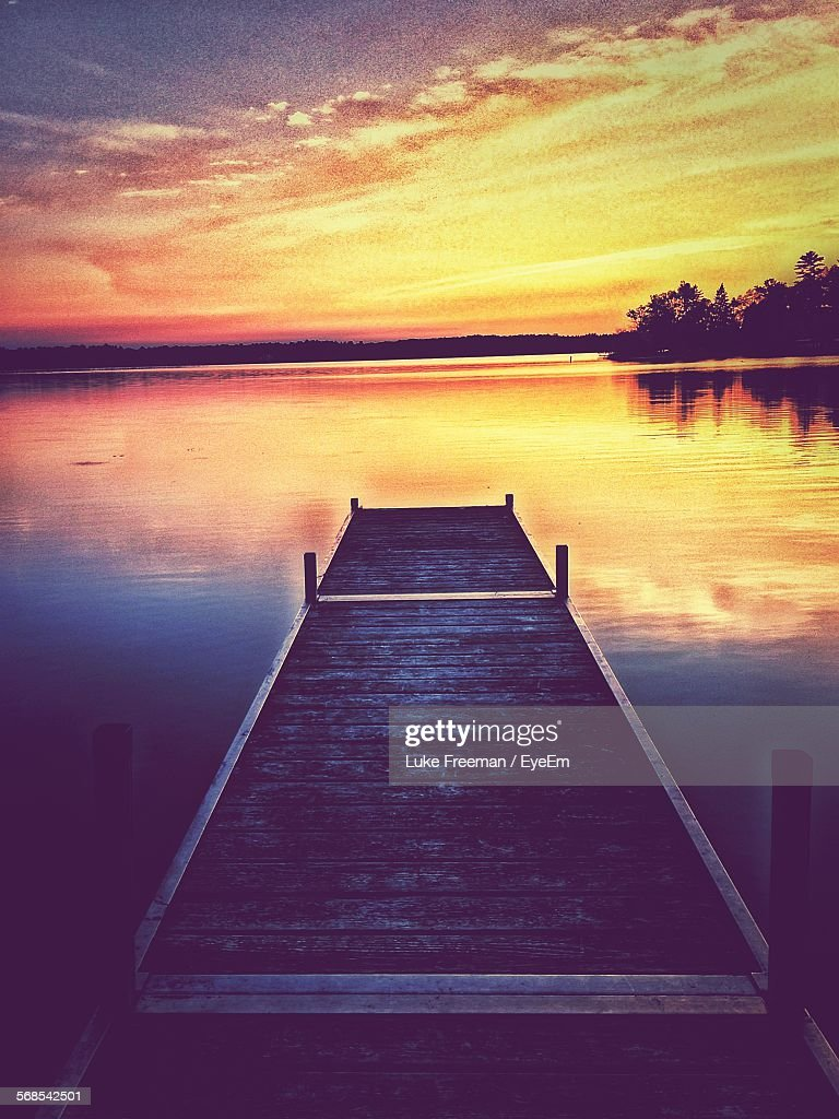 Wooden Pier Over Lake During Sunset : Stock Photo