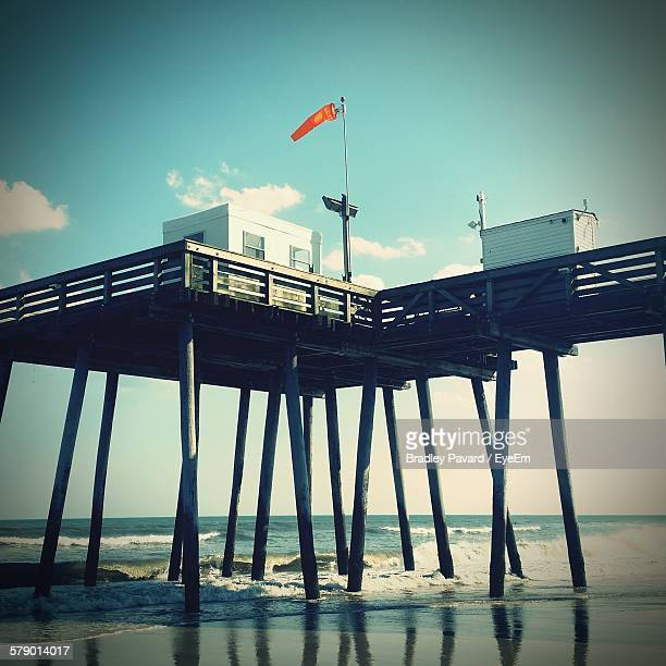 wooden pier over sea against sky - pavard stock pictures, royalty-free photos & images