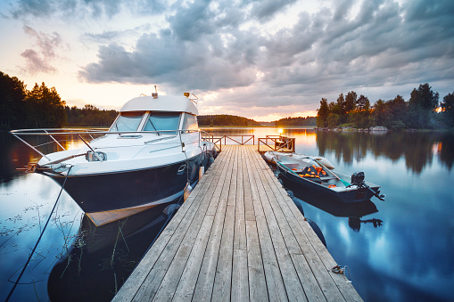 Wooden pier with boat 937731582