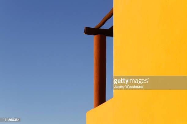 Wooden pillar on balcony against sky