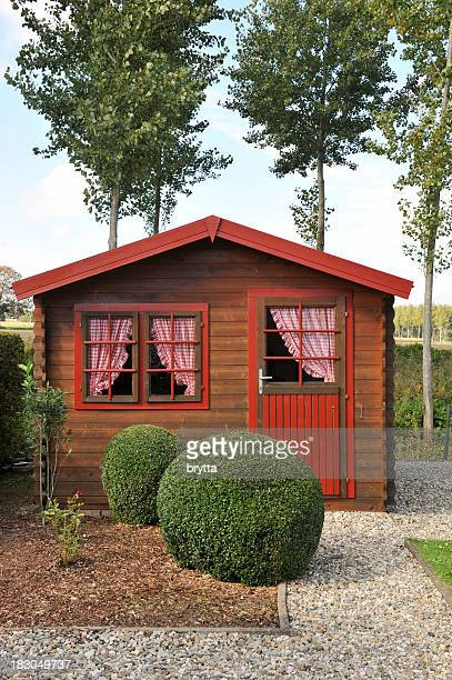 wooden pine shed with curtains in the back yard - shed stock pictures, royalty-free photos & images