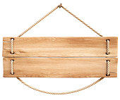 A wooden plank sign held by a rope