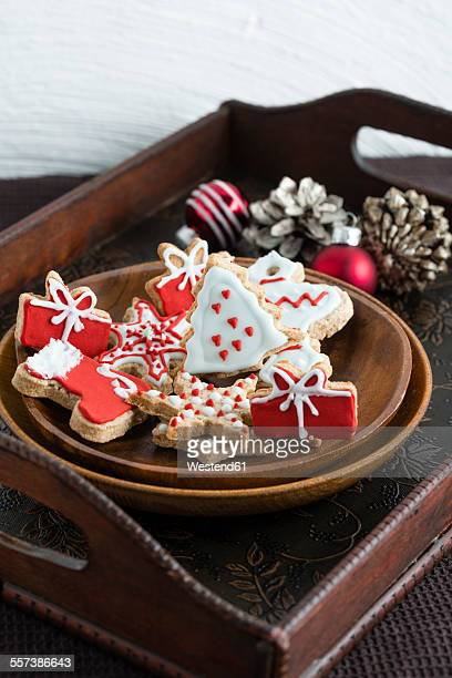 Wooden plate of home-baked Christmas cookies