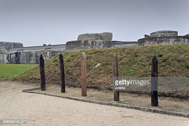 Wooden poles for execution of political prisoners at Fort Breendonk Belgium