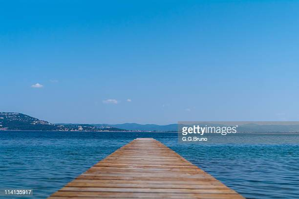 Wooden pontoon with the distant shore afar