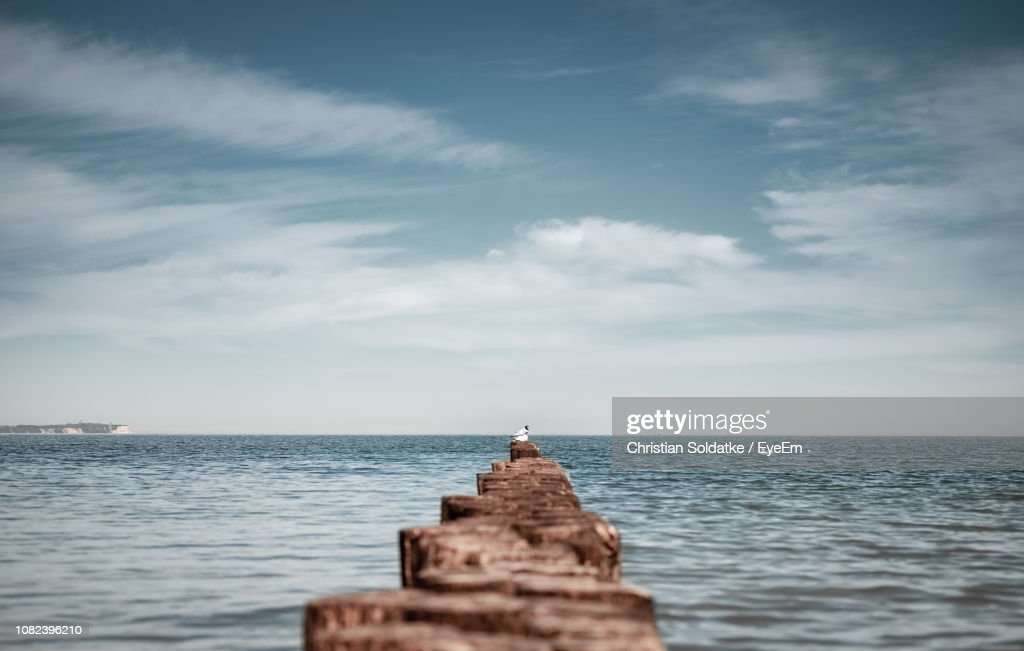 Wooden Posts In Sea Against Sky : Stock Photo