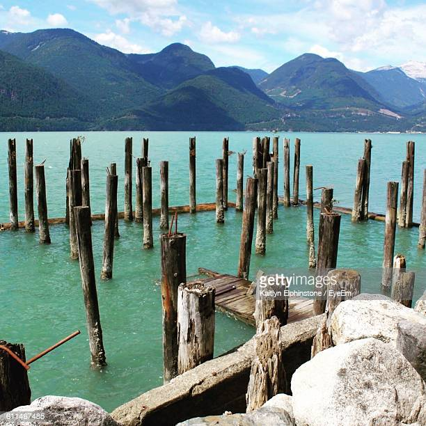 Wooden Posts In Sea