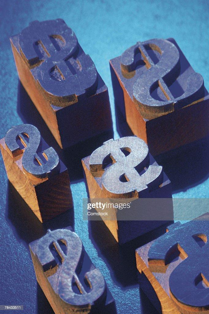 Wooden printer's blocks with dollar signs : Stockfoto