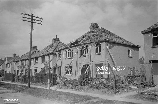 Wooden props hold up a pair of damaged semi detached houses after a German Luftwaffe Heinkel bomber crashed in Victoria RoadClactononSea Essex during...