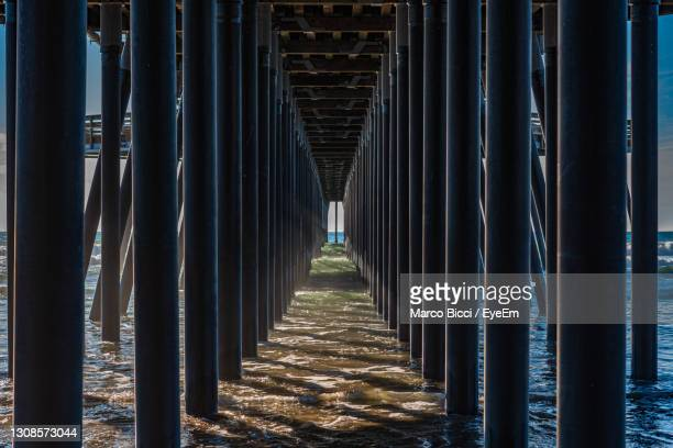 wooden pylon of a pier - pismo beach stock pictures, royalty-free photos & images