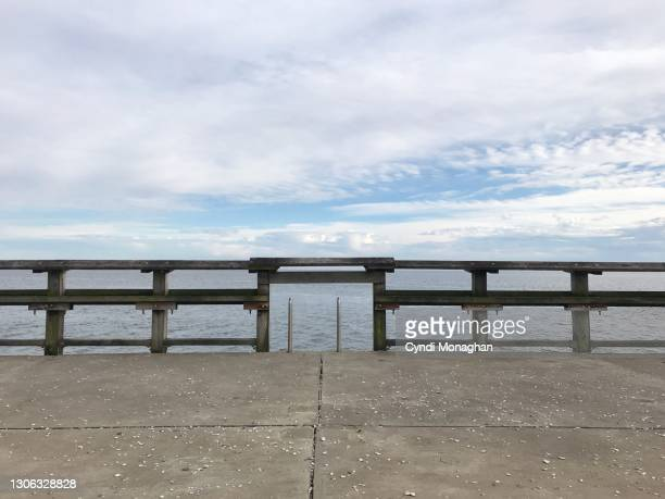 wooden railing and ladder and view of the chesapeake bay, north point state park - maryland us state stock pictures, royalty-free photos & images