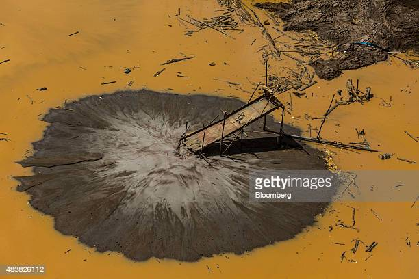 A wooden ramp used to separate gold sits in a pond at an abandoned illegal mine in this aerial photograph taken above the Amazonian National Reserve...