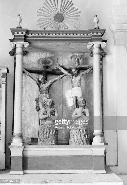 Wooden religious statues stand near the front altar January 1, 1982 of a Catholic church in Santa Cruz del Quiché, Guatemala. There are approximately...
