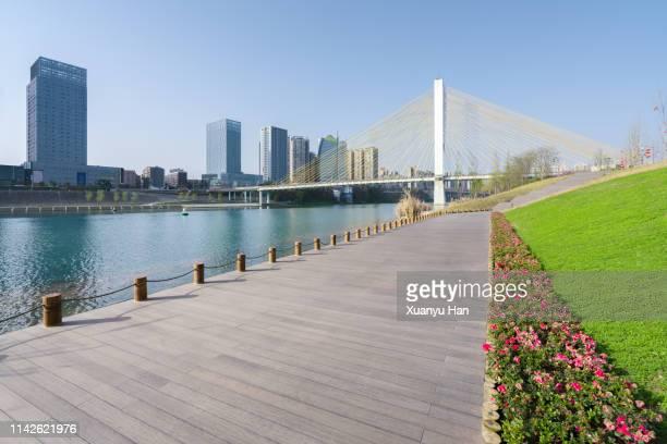 wooden road in city - 川岸 ストックフォトと画像