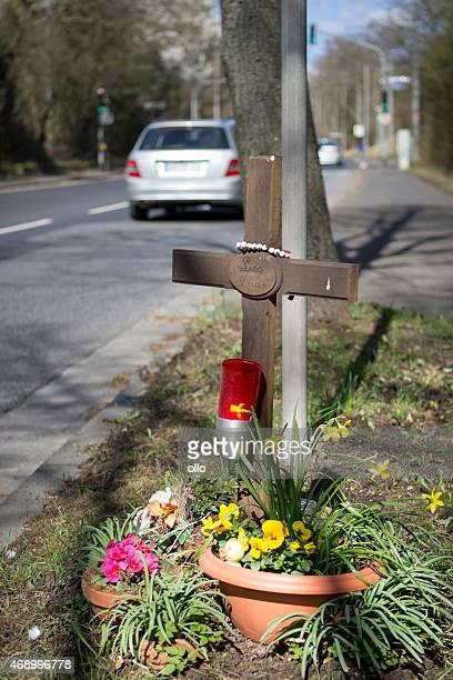 Wooden roadside memorial for Lisa beside the road