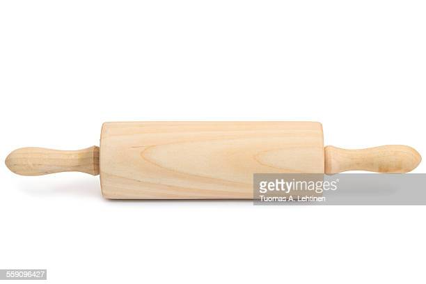 A wooden 'roller' type rolling pin with shadow