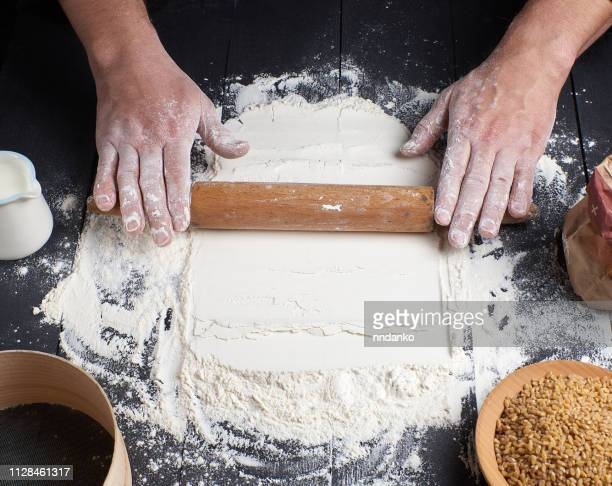wooden rolling pin male hands next
