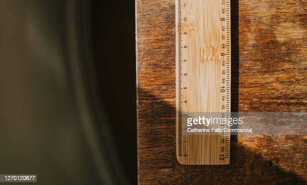 wooden ruler on a wooden table - punishment stock pictures, royalty-free photos & images
