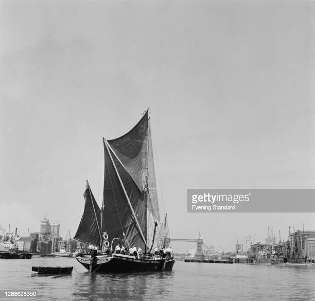 Wooden sailing barge 'May' from Ipswich on the River Thames in London, with Tower Bridge in the background, UK, July 1971.