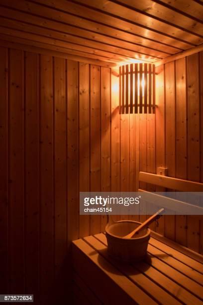 wooden sauna with traditional sauna accessories for healthy and medical. - sauna stock-fotos und bilder
