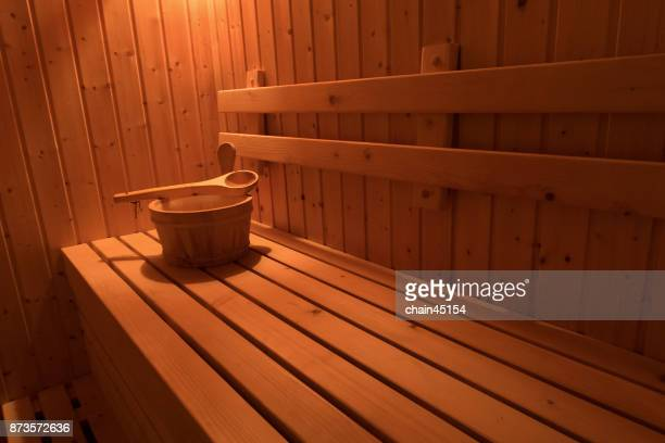 Wooden sauna with traditional sauna accessories for healthy and medical.