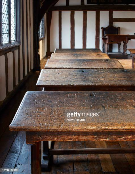 Wooden school desk with carved names Shakespeare's Schoolroom StratforduponAvon United Kingdom Architect Wright Wright Architects LLP 2016