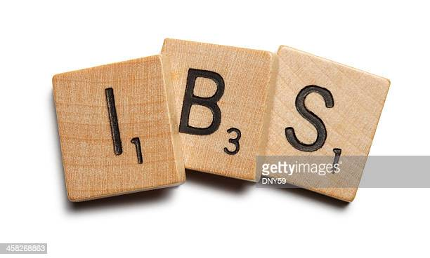 "Wooden scrabble tiles spelling ""IBS"""