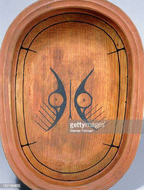 Wooden serving dish with stylized animal face decoration based on nucleated circle eyes This motif called ellam iinga in central Yupik has been used...