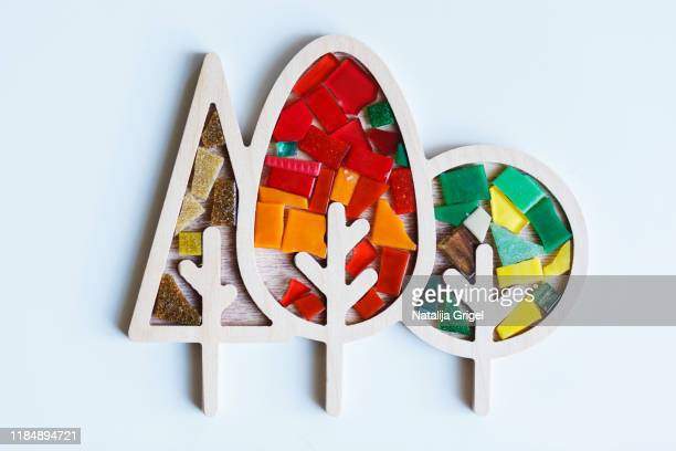 wooden shape trees with ceramic mosaic