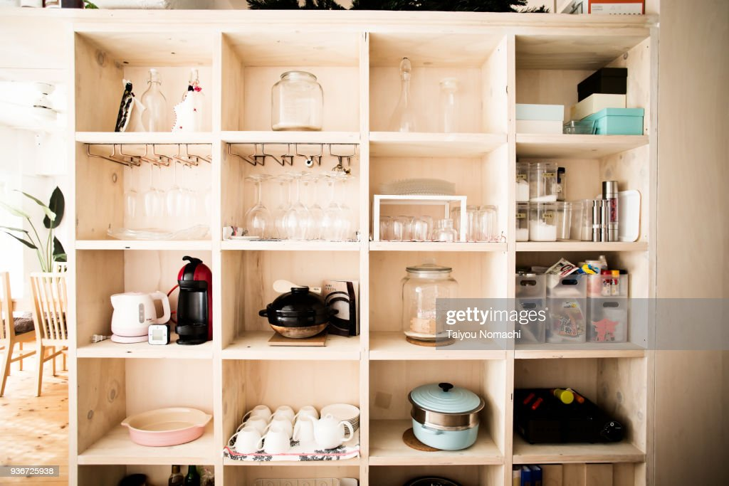 Wooden shelves with dishes arranged : Stock Photo